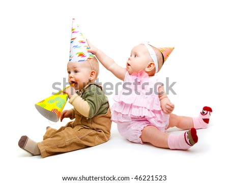 Two lovely kids with party hats on, isolated - stock photo