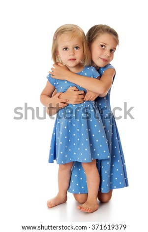 two lovely sisters - stock photo