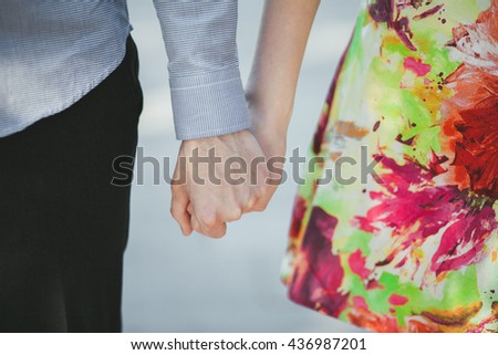 Two lovers holding hands, close-up, couple