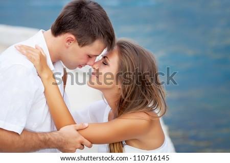 Two lovers near the seashore - stock photo