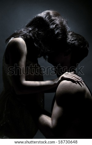 two lovers over dark background - stock photo