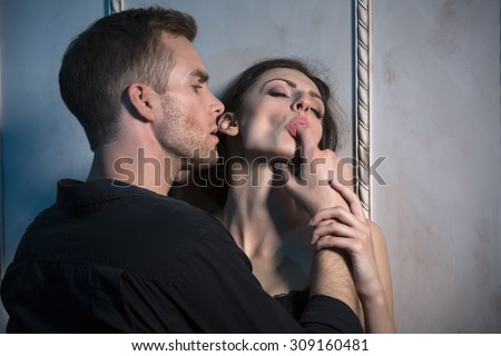 Two lovers under the wall of a beautiful interior - stock photo