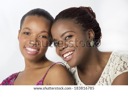 Two Loving Best Friends laughing sitting close
