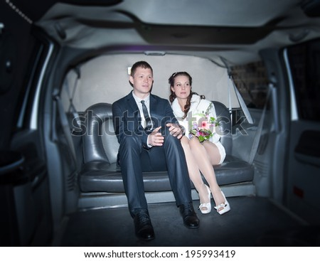 two loving people are sitting in a limousine wedding day - stock photo