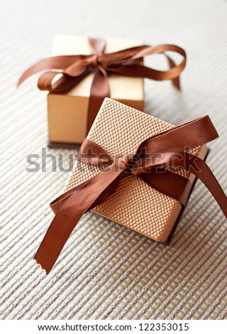 Two luxury gift boxes with ribbon and bow - stock photo