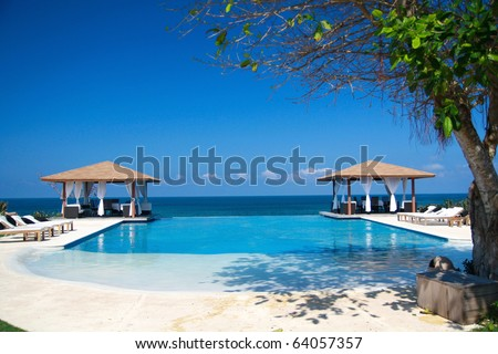 Two luxury summerhouses with swimming pool near ocean, Dominican Republic - stock photo