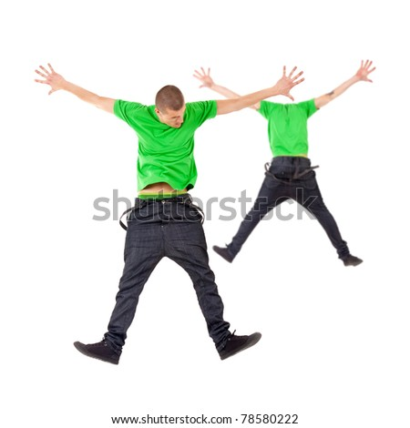 Two male break dancers jumping on studio background - stock photo