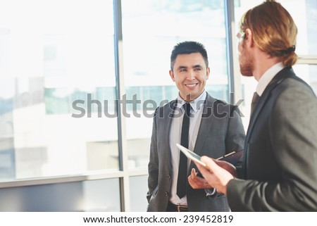 Two male colleagues having business meeting - stock photo