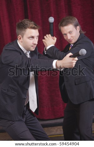 two male comedians acting on the stage - stock photo