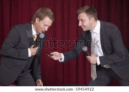 two male comedians on the stage playing theater - stock photo