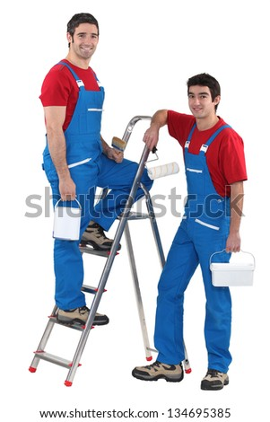 Two male decorators wearing matching outfits - stock photo