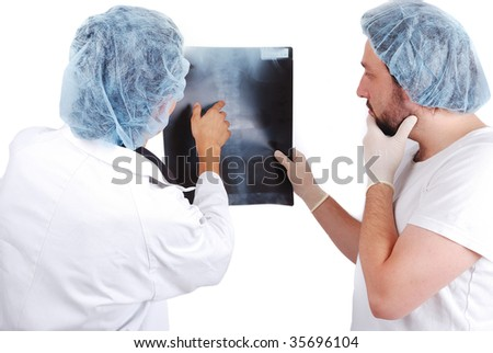 Two male doctors looking at scan image