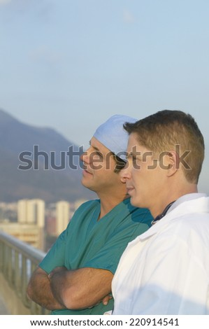 Two male doctors on balcony - stock photo