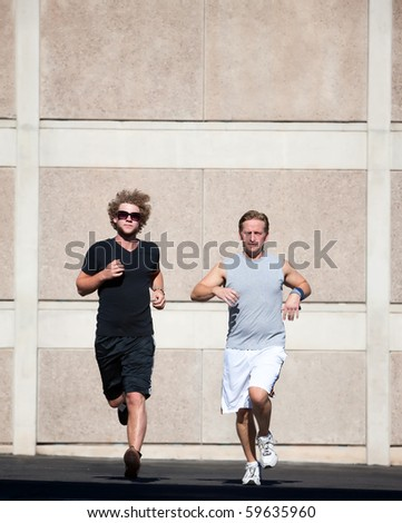 Two male friends practice for race - stock photo