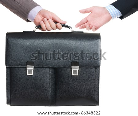 Two male hands and black leather briefcase over white background