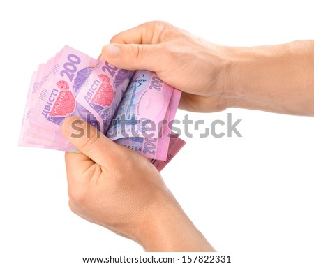 Two male hands counting Ukrainian hryvnia. Isolated over white. - stock photo