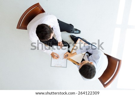 Two male managers discussing business graph - stock photo