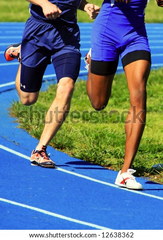 two male runners competing - stock photo