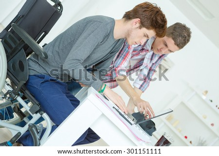 Two male teenagers studying at home - stock photo