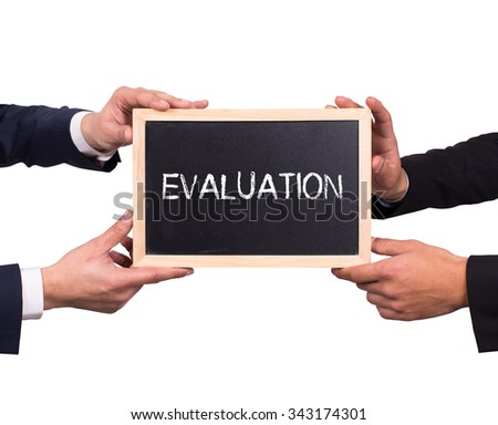 Two man holding mini blackboard with EVALUATION message - stock photo