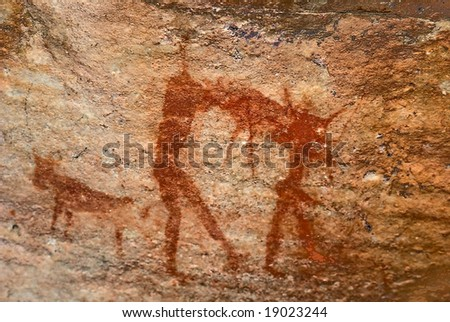 two man hunting. bushman's prehistoric tribal cave art in mountains of south africa - stock photo