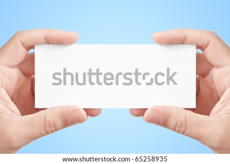 Two man's hands holding long blank paper business card on light blue background, copy space fot your message or adverisment - stock photo