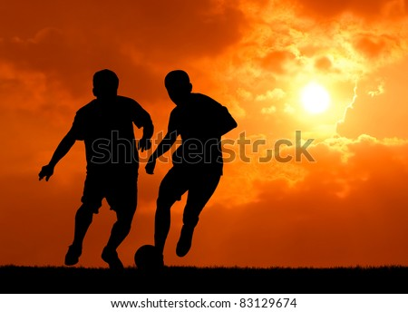 two man soccer player playing with ball during sunset silhouetted - stock photo