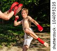 Two man training Muay thai in forest - stock photo