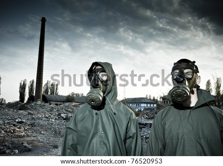 Two man wearing gas masks after nuclear disaster - stock photo