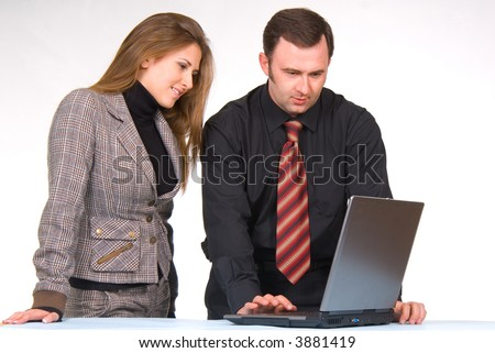 Two managers communicating, working on laptop computer
