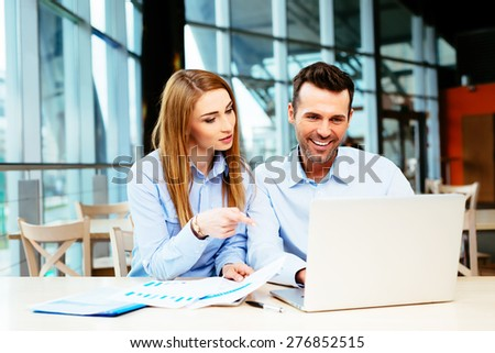 Two managers evaluating a website in an office - stock photo