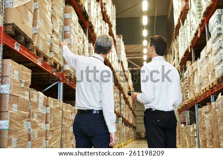 two managers workers in warehouse with bar code scanner - stock photo