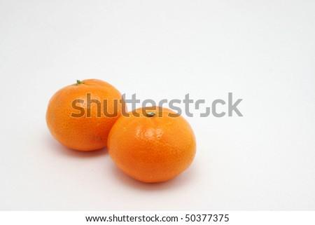 Two Mandarin oranges - stock photo