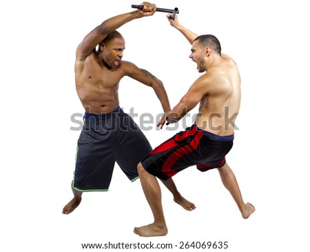 two martial artists sparring with Kali Escrima or Arnis  - stock photo