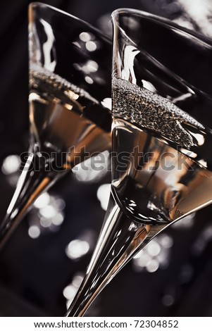 two martini  glasses in front of the night lights - stock photo