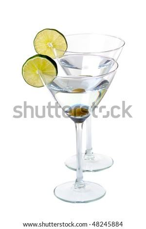 two martini glasses with slice of lime isolated on white background