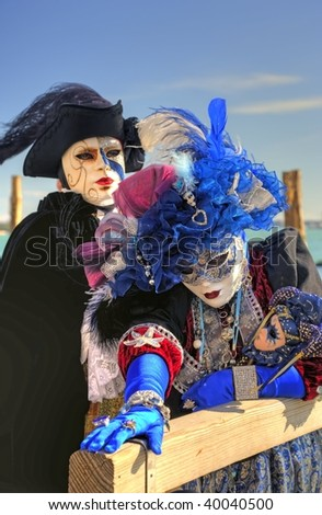 Two masks at the pier in Venice