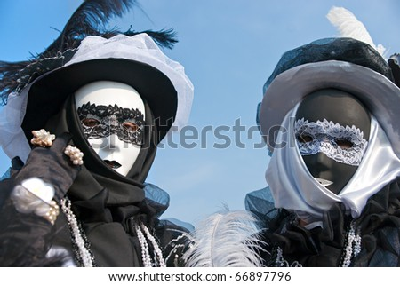 Two  masks in Venice, Italy. - stock photo