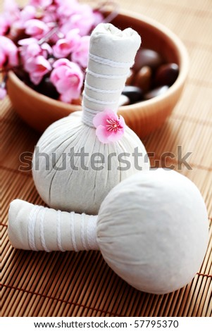two massage stamps with bowl of stones - beauty treatment - stock photo