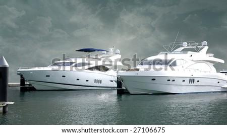Two massive yachts on the dubai marina dock yard. - stock photo