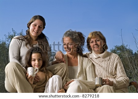 Two Mature one Young Adult Women and a Girl - stock photo