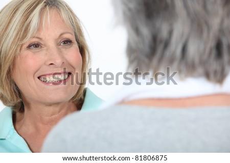 two mature women talking - stock photo