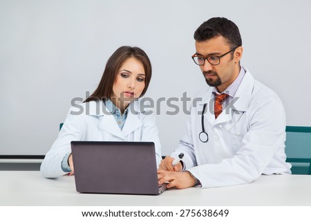 two medic science professionals working together on a project - stock photo