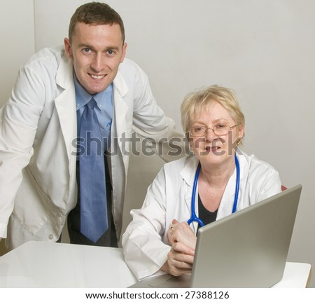 Two medical professionals consulting
