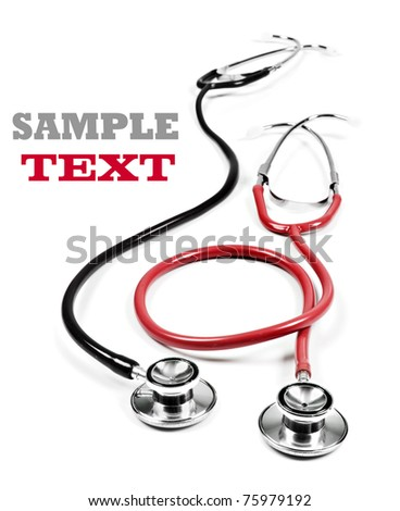 Two medical stethoscopes on a white background - stock photo