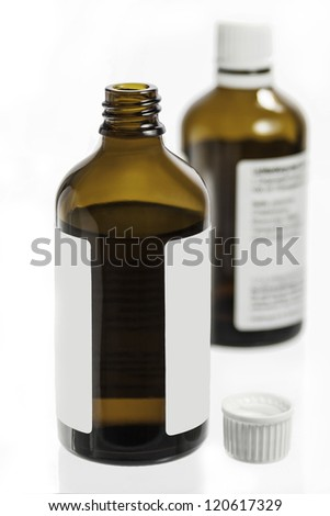 two medicine bottles are isolated against a white background - stock photo