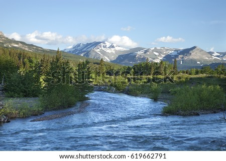 Two Medicine River and mountains in morning light near Glacier National Park