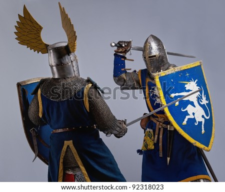 Two medieval knights fighting. - stock photo