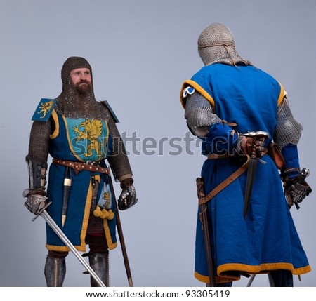 Two medieval knights preparing to fight. - stock photo