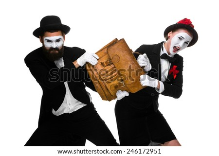 Two memes as business man and woman fighting over briefcase isolated on white background. the concept of the struggle for power and position - stock photo